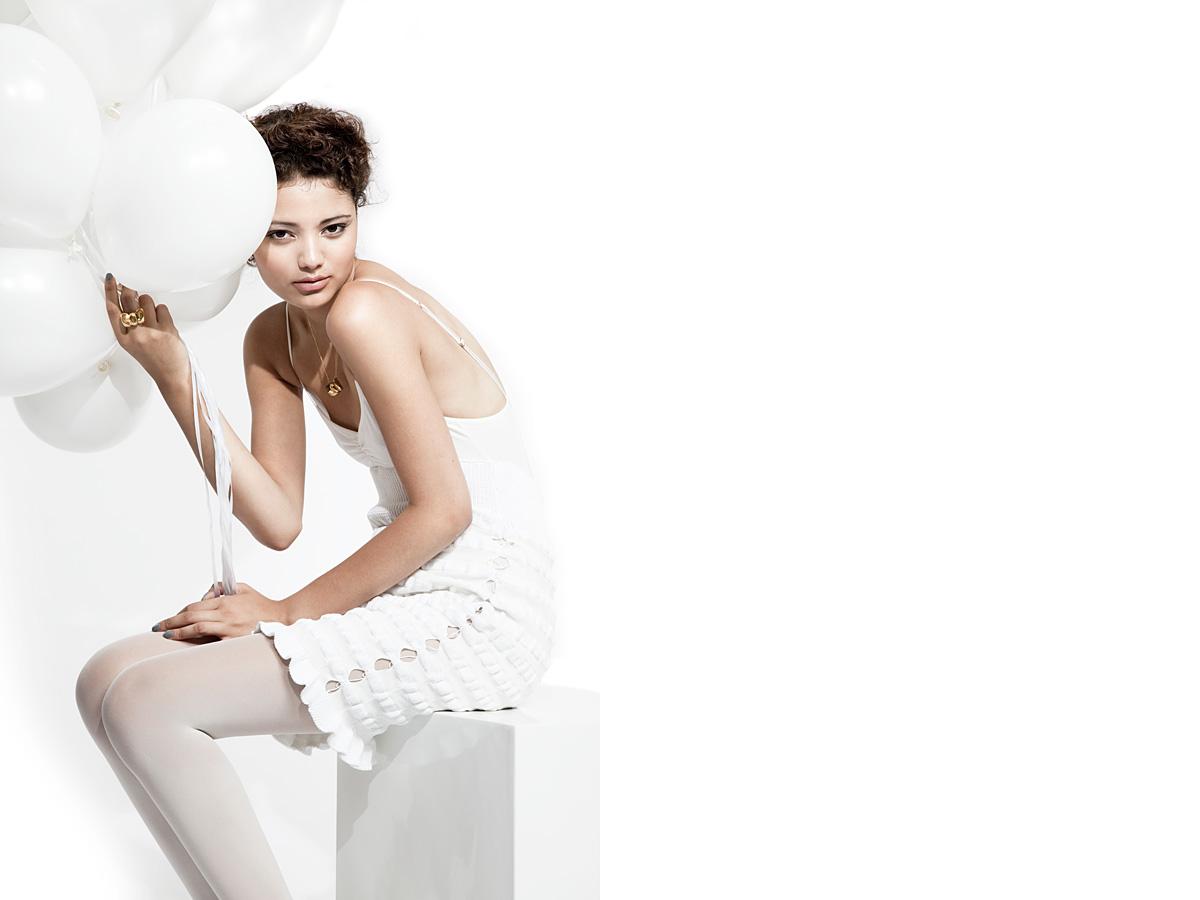 Photo: studio Fashion Campaign Photographer, Retoucher, Margaret Yescombe, All White fashion shoot, Model, Sana, Models 1 agency, perfume advert, jewellery, balloons, clean, fresh, bright