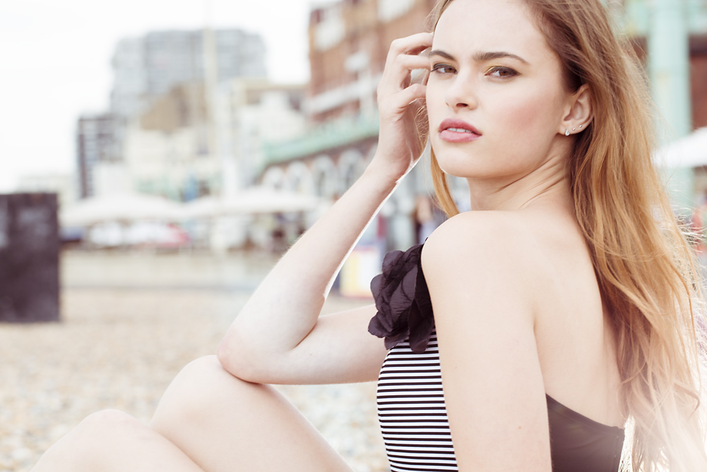 Photo: Brighton Beach location photo-shoot, designer swimwear, imagery by fashion campaign photographer Margaret Yescombe, model Tamara Milk Management, Swimwear by Sumarie, MUA/Hairstylist Christiana Howell, flower broach photographers own, earrings model's own. Creative Director, Photographer, Retoucher: Margaret Yescombe Photography London