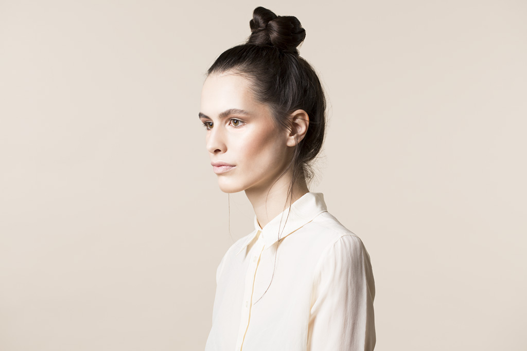 Photo: studio beauty cosmetics campaign photographer Margaret Yescombe, Make-Up Artist Hairstylist Dorota Nowacka, Model Elisabeth. Pale look, cream shirt, hair bun knot, profile image