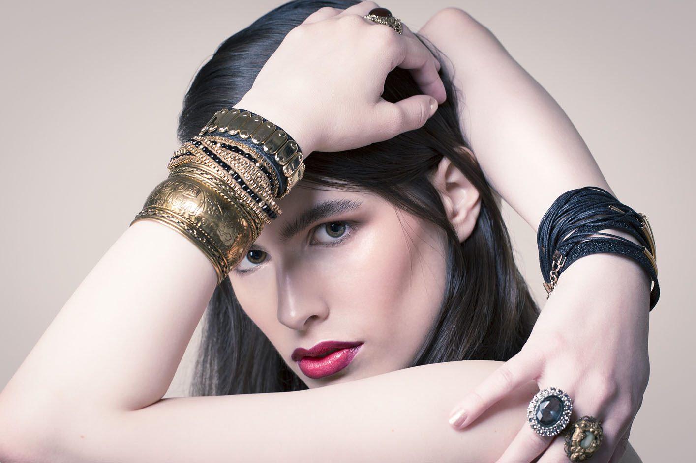 Photo: studio beauty cosmetics jewellery campaign photographer London studio Margaret Yescombe, Make-Up Artist Hairstylist Dorota Nowacka, Model Elisabeth. Red two-tone lipstick, stacked bracelets bangles metal and leather, costume jewellery diamond ring