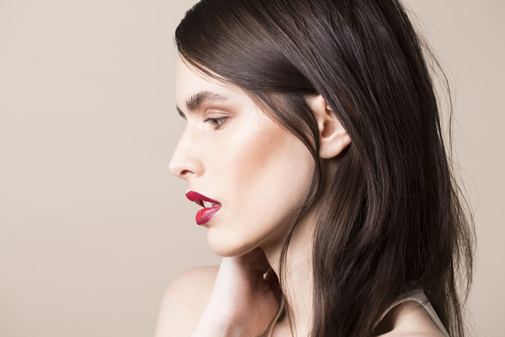 Photo: studio beauty cosmetics campaign photographer Margaret Yescombe, Make-Up Artist Hairstylist Dorota Nowacka, Model Elisabeth. Red lipstick, blusher, profile image