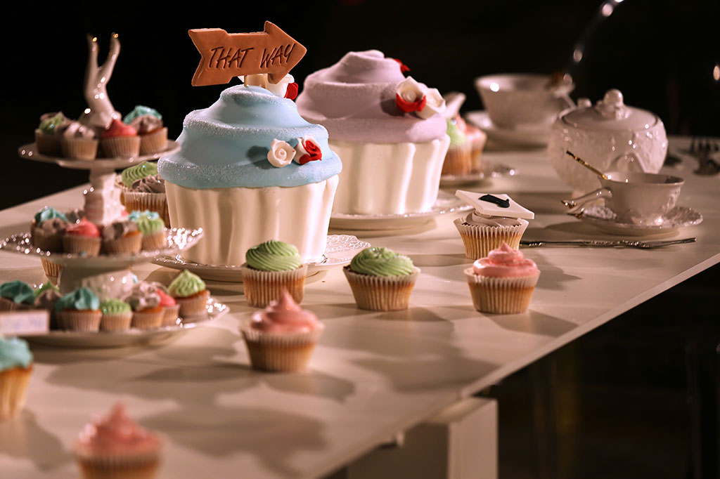 photo: cupcakes on table, sign says That Way