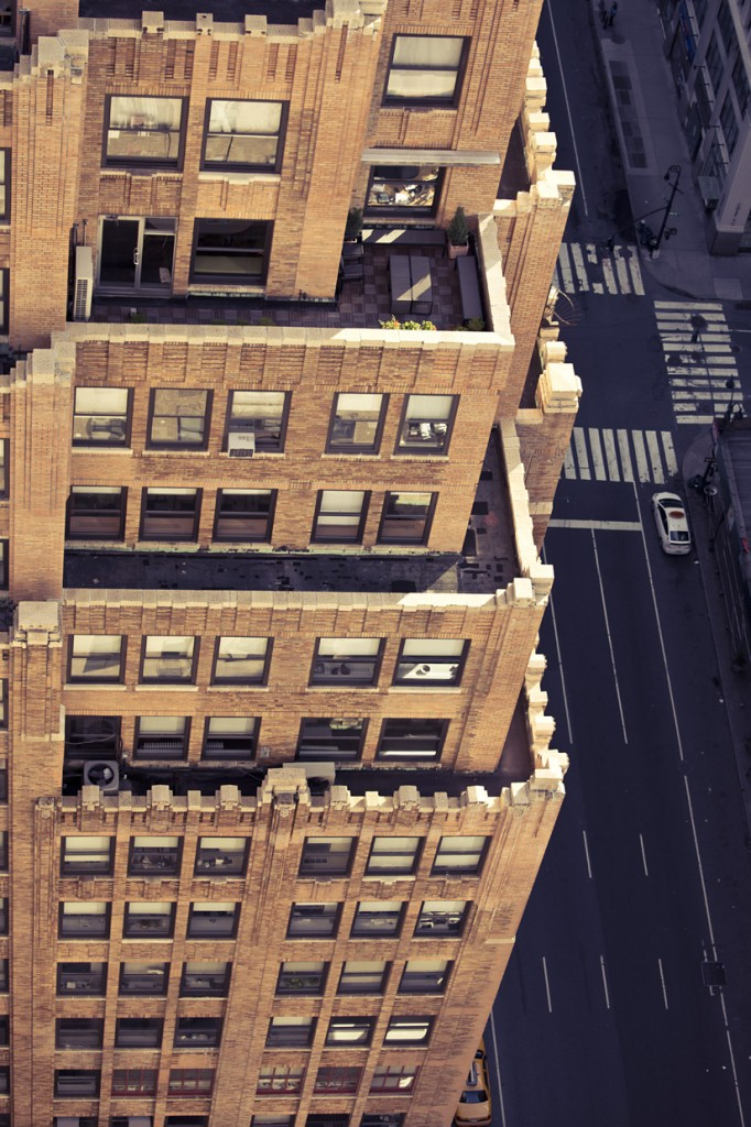 aeriel view photograph of new york city streets cross walk balcony car cab