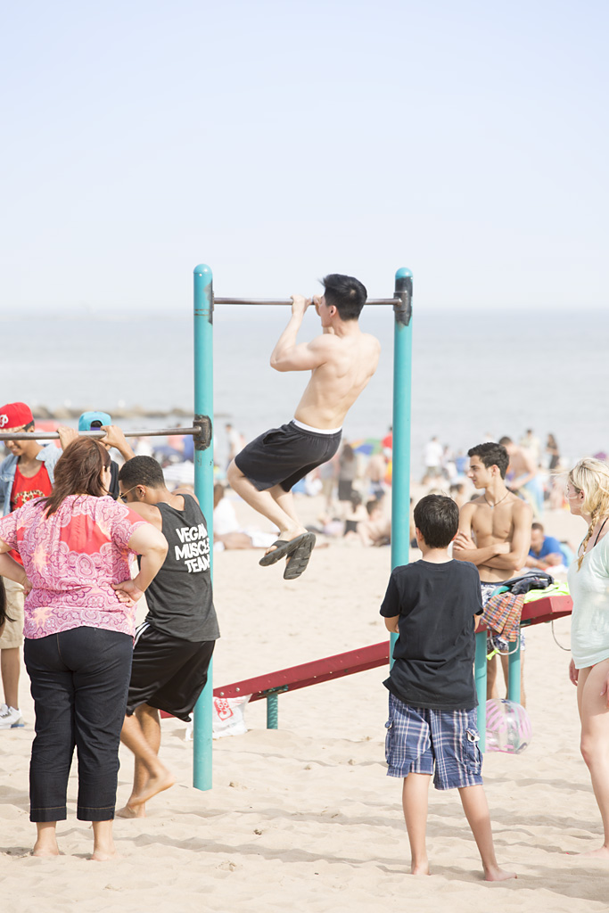 Photo: muscle men, sun sea and sand, Coney Island Beach, Brooklyn, New York, beach re-opens, memorial day weekend, travel and documentary photography by fashion and pr photographer Margaret ( Maggie ) Yescombe, London UK