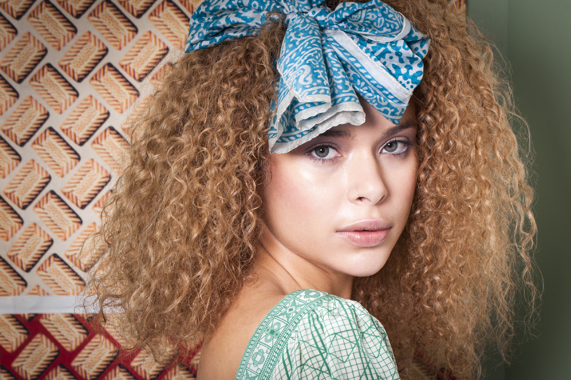 Photo: beauty and cosmetics campaign photographer London, Margaret Yescombe. Agency Model, natural look make-up, curly hair, ribbon, patterns, fashion, colourful, electric, ethic, beautiful, stunning, imagery