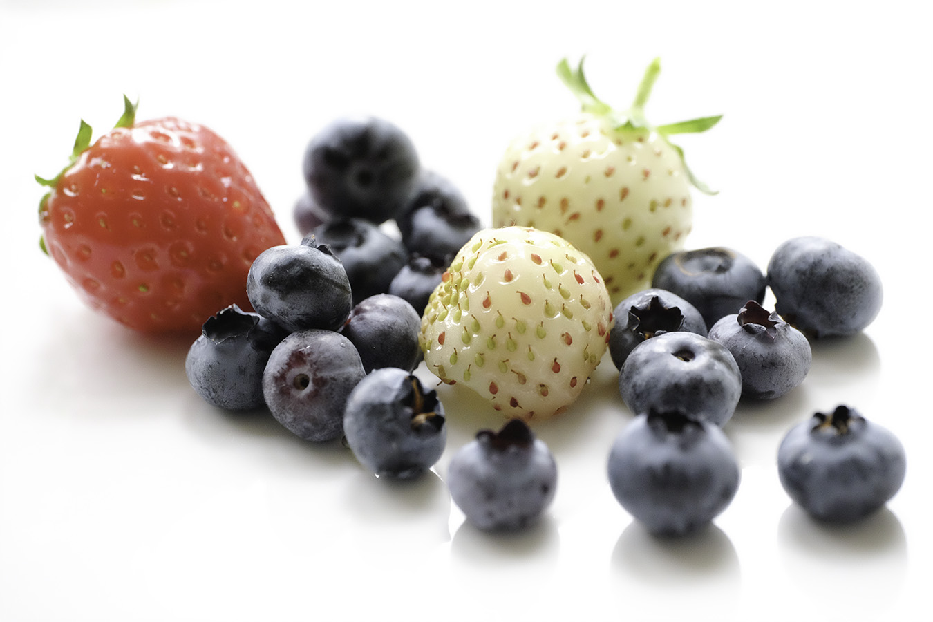 Photo: London food photography, by photographer and retoucher margaret yescombe, fruity berries, white background
